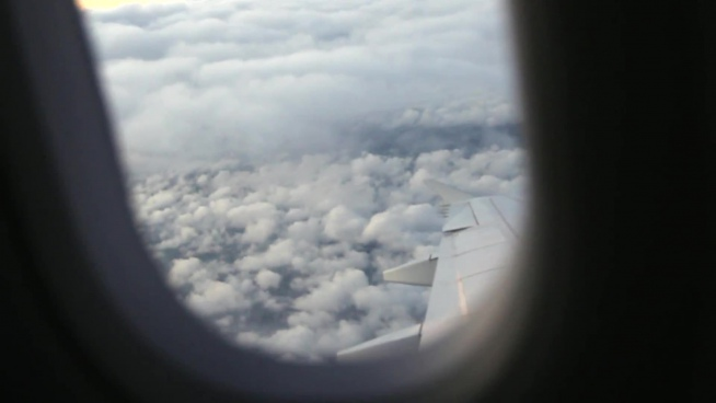 white cloudy scene outside of airplane window
