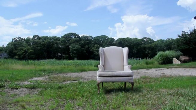 white armchair abandoned outdoor