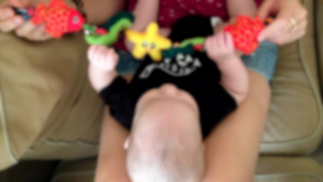 blurred clip of little baby playing with toys