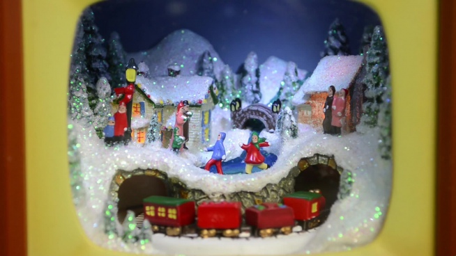christmas decoration with train model moving in tunnel