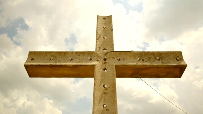 metallic christian cross under sky