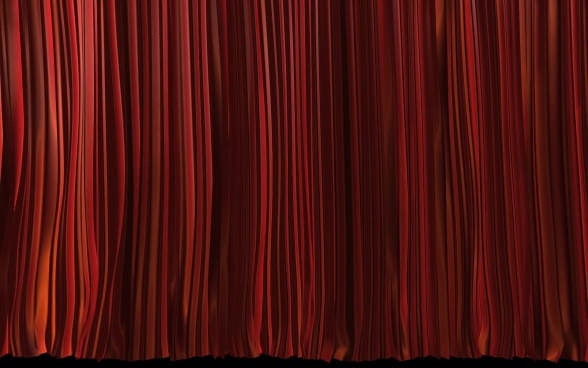 red curtain swinging on stage
