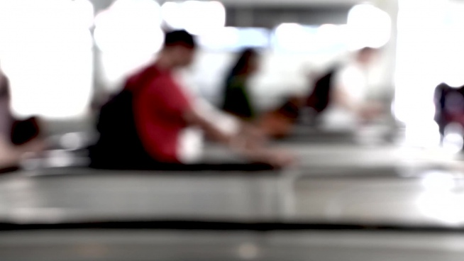bokeh clip of pedestrian moving on escalators