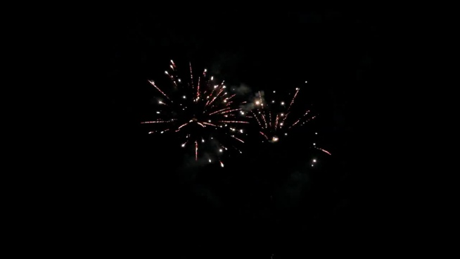 beautiful sparkling fireworks explosion on dark sky