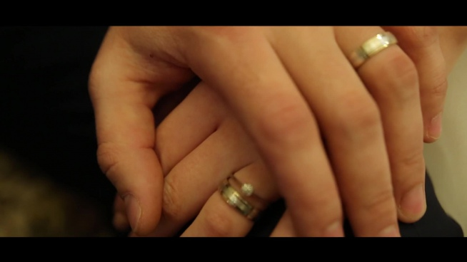 closeup of marriage couple with hand in hand