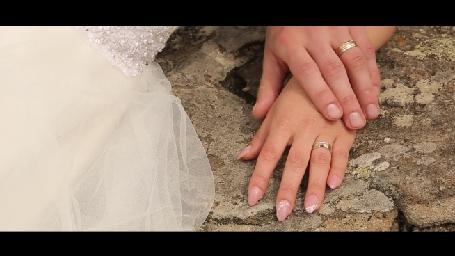 closeup of romantic groom and bride hands