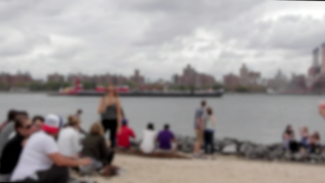 blurred video of crowd relaxing on sea bay