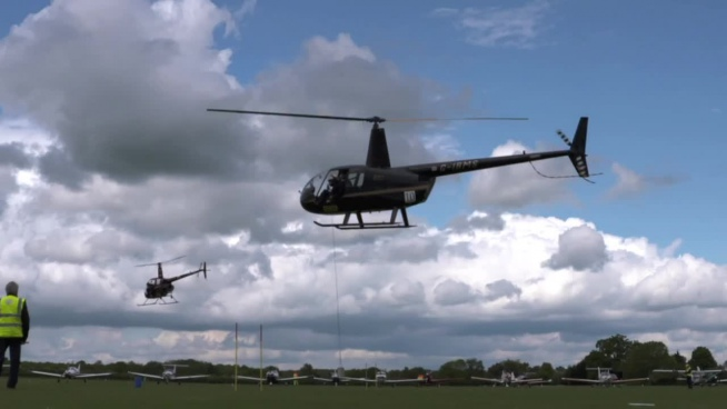 modern helicopter flying in airshow