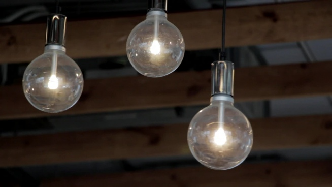 hanging light bulbs swinging in air