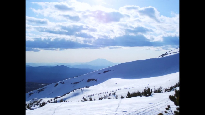 fast clip of cloudscape flying above snowy mountain