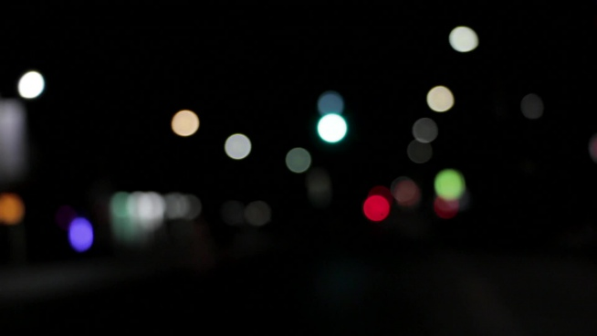bokeh clip of colorful lights in darkness