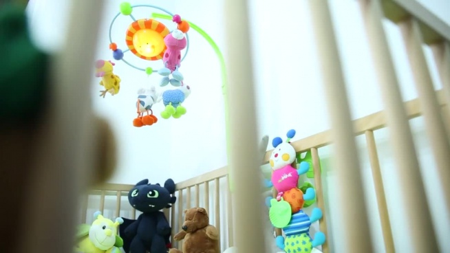 cute kid toys decoration on cradle