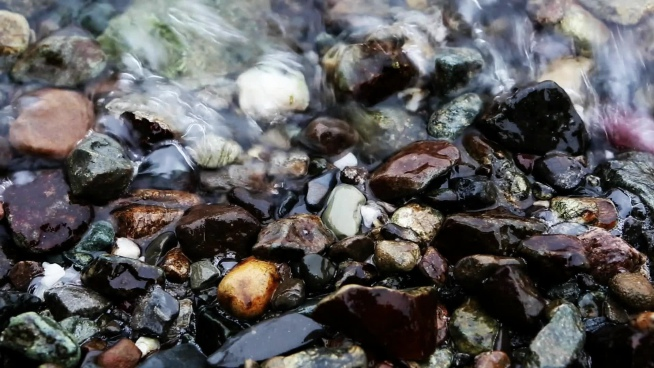 of wave splashing on beach pebbles