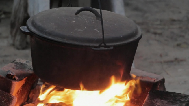 closeup of traditional pot on cooking fire