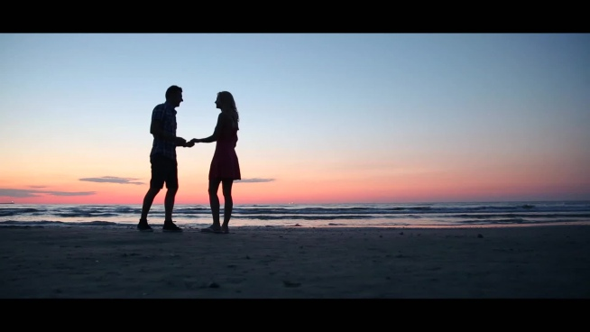 romantic couple engaged at sunset
