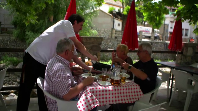clip of outdoor lunch gathering with traditional cuisine