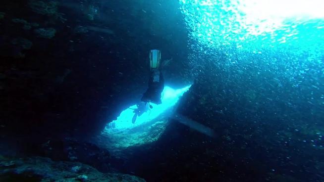 diver exploring deep ocean