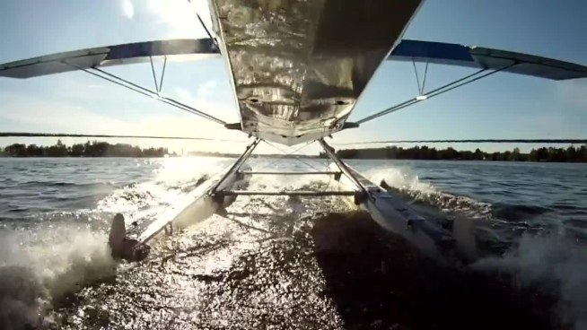 self clip of seaplane taking off on water