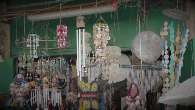 decorated wind chimes swinging in store