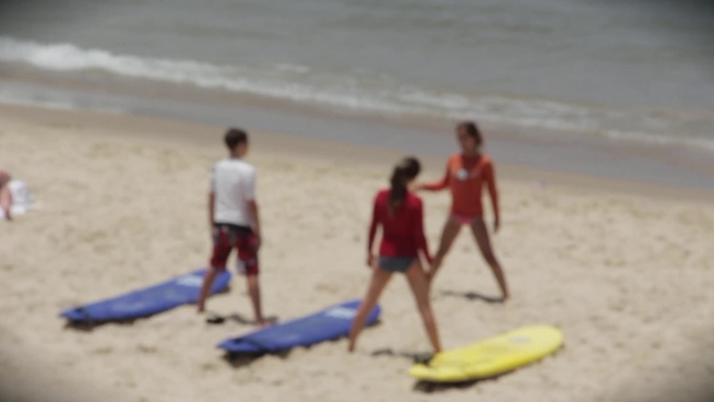 bokeh clip of youth doing exercise on beach