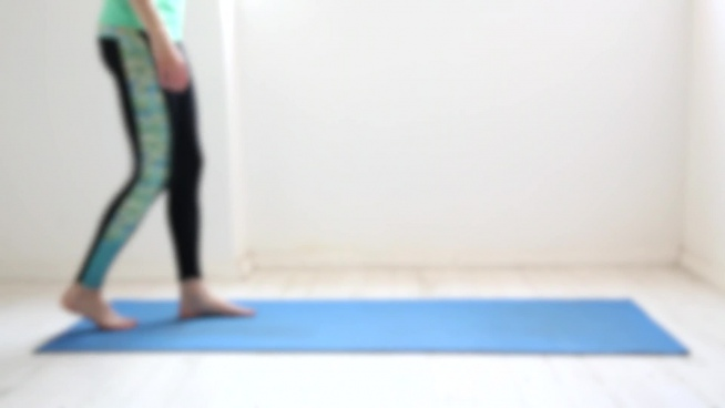 blurred clip of sporty woman practising yoga