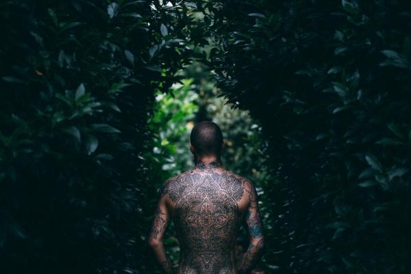 stylish man with full tattoo on back