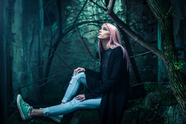 beautiful stylish woman in forest
