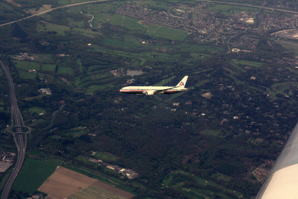 american airlines flight in the air above south of london