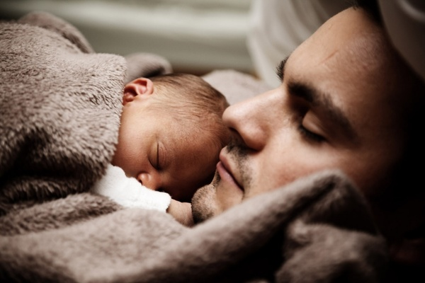 baby and dad sleeping