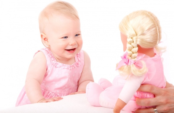 baby girl and doll