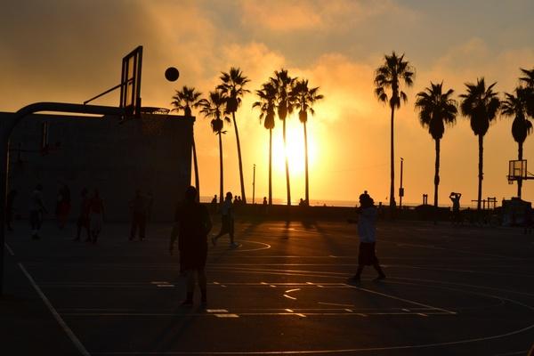 backlit beach boardwalk dusk evening golden light