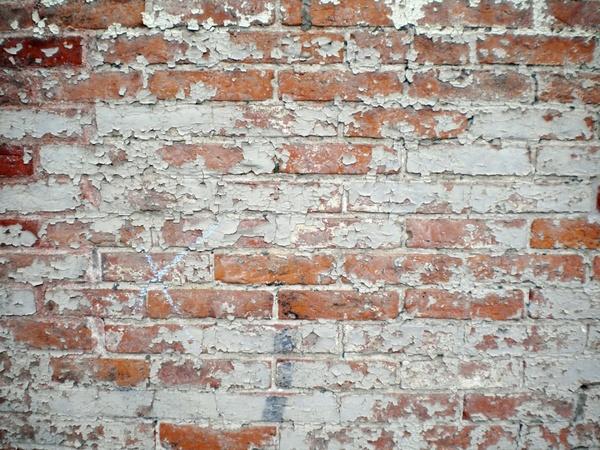 brick wall peeling paint