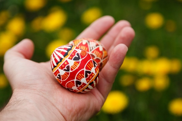 easter eggs in hand