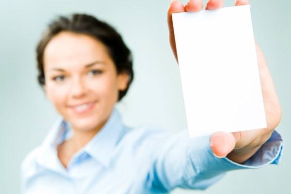 figure holding a blank business card highdefinition images
