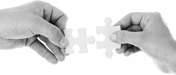 hands holding jigsaw