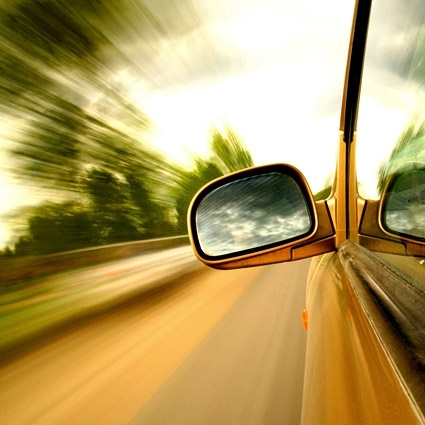 high speed in a car rearview mirror picture