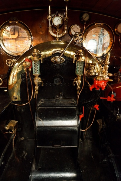 inside the cab of a steam engine