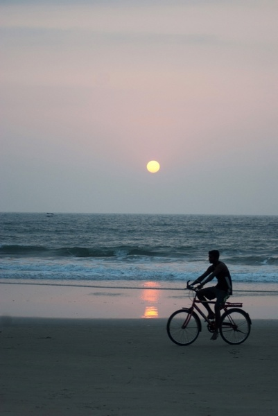 man on the bicycle on the beach