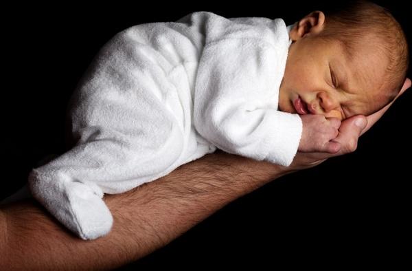 newborn baby on an arm