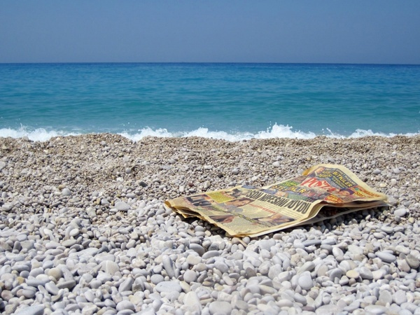 newspaper on beach