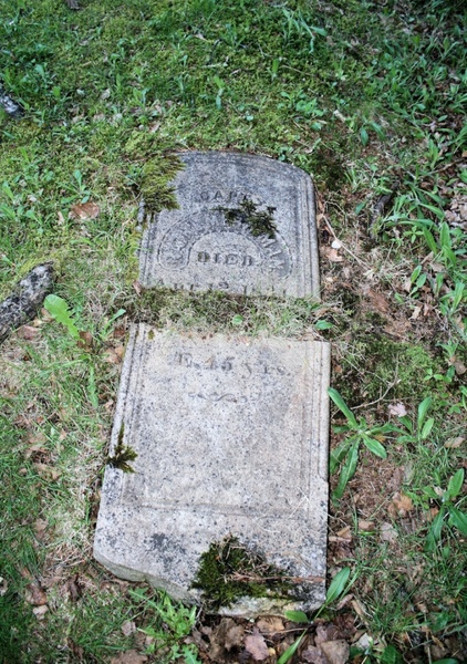 old broken headstone