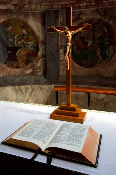 open bible and crucifix