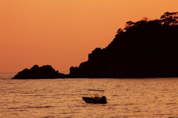 orange boat at sea