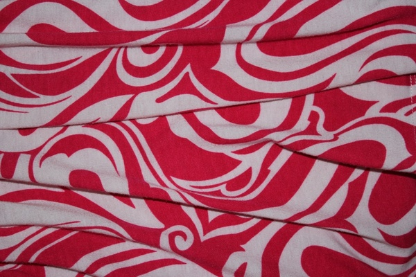 pink textile twirl background