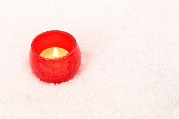 red candle in snow