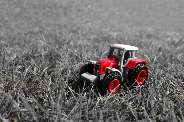 red tractor in the grass