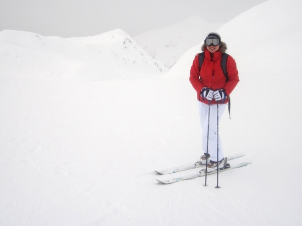 skier at mountain peak