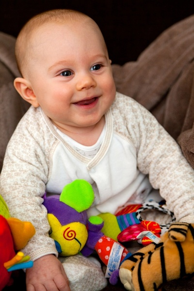 smiling baby with toys
