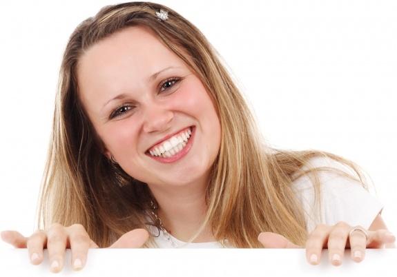 smiling woman behind board