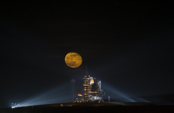 rocket launching pad under bright round moon